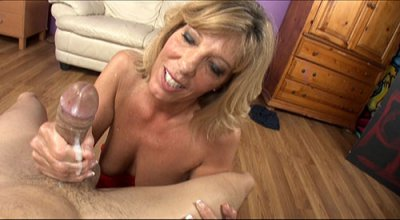 Nasty Blonde Cougar Gives This Young Stud A Raunchy Tug Job