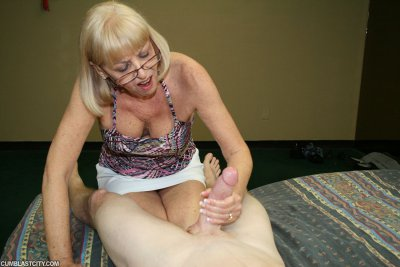 Blonde Granny Gets Her Face Blasted With Fresh Cum After A Hand Job